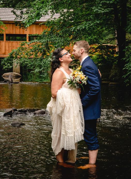 New England elopement couple in river