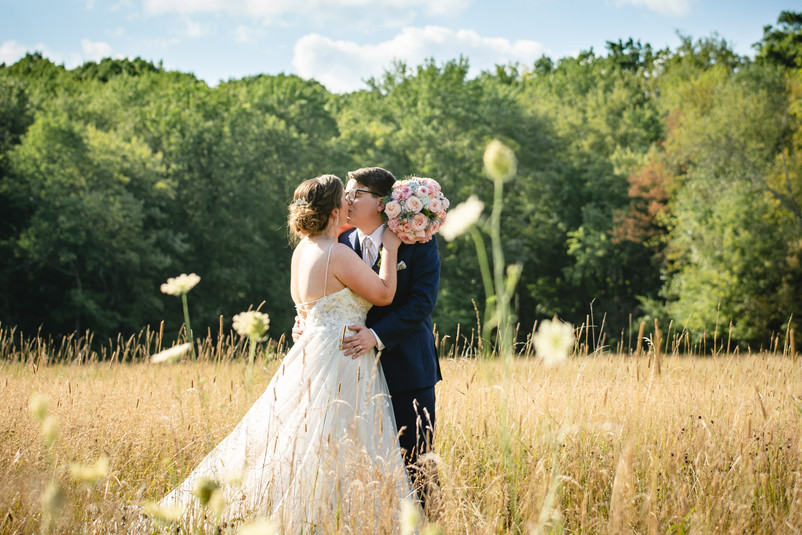 Massachusetts elopement photography - couple kissing in field