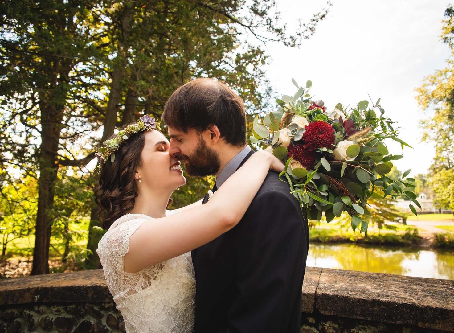 bride and groom kissing at Elizabeth Park CT wedding photographer