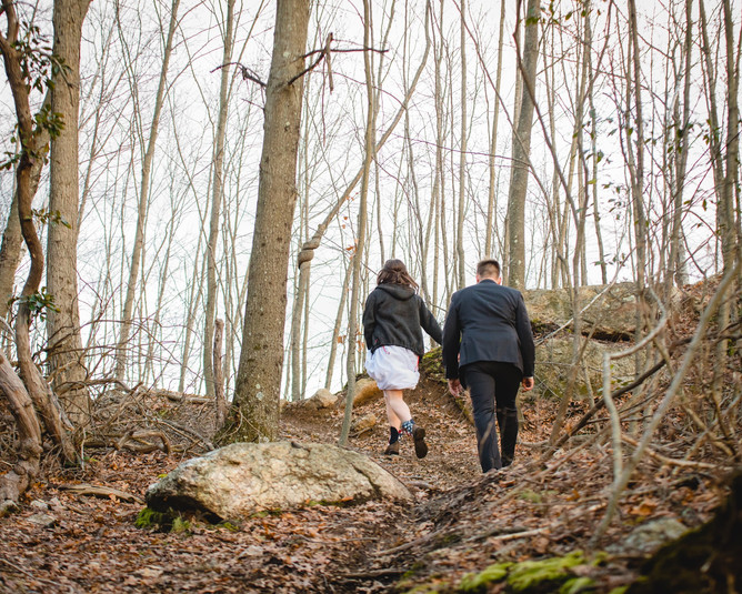 CT elopement couple hiking through woods