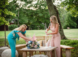 CT wedding planner Brehant Creations putting the final touches on table decor