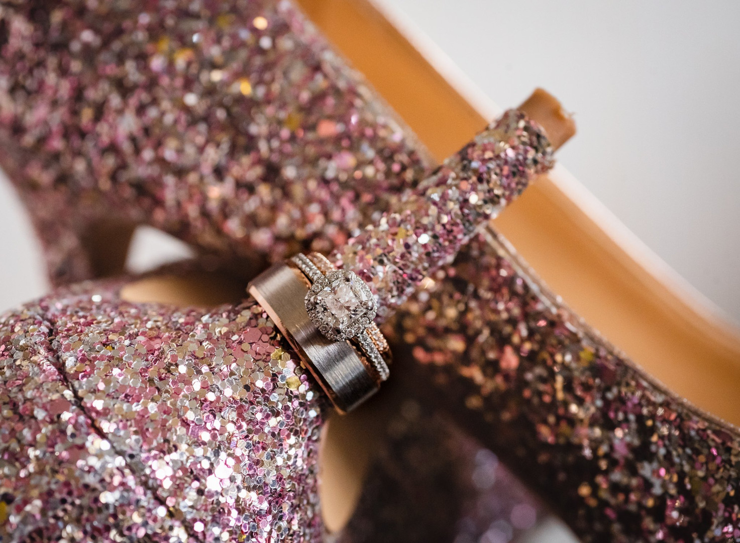 wedding rings and glitery bridal shoes