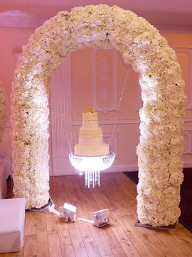 WEDDING FLORAL ARCH CAKE SWING