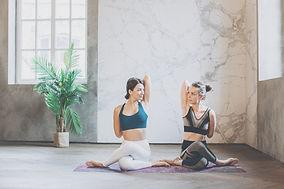 2-women-sitting-on-galaxy-design-yoga-ma