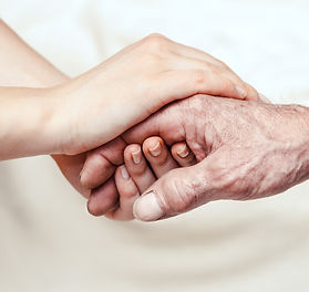 Hands of the old man and a young woman.