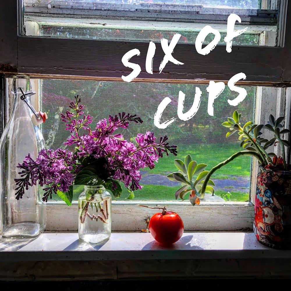 Tomato, lilac and glass jar still life in a farmhouse