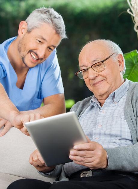 Happy male nurse helping senior man in u