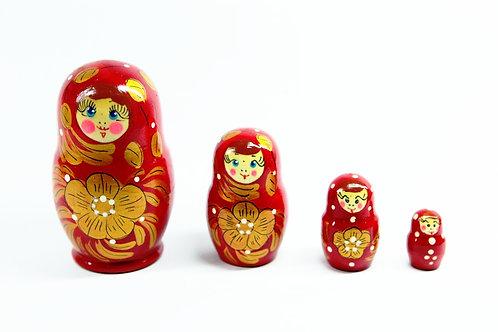 Bonecas Matrioskas Vermelhas com flor dourada