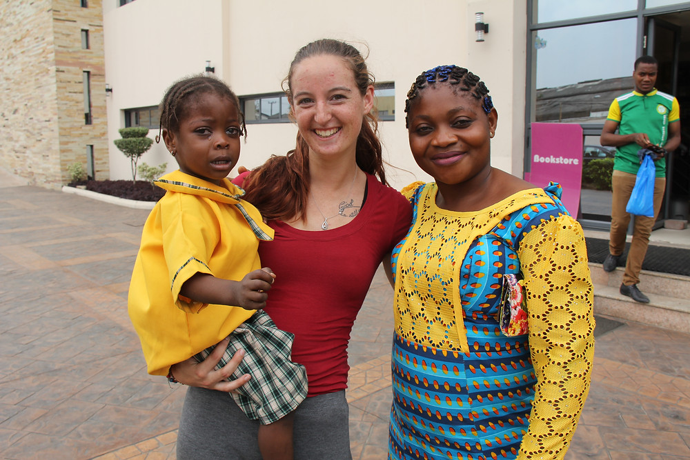 Picture of child scholars volunteer with some of a child scholar and her mum