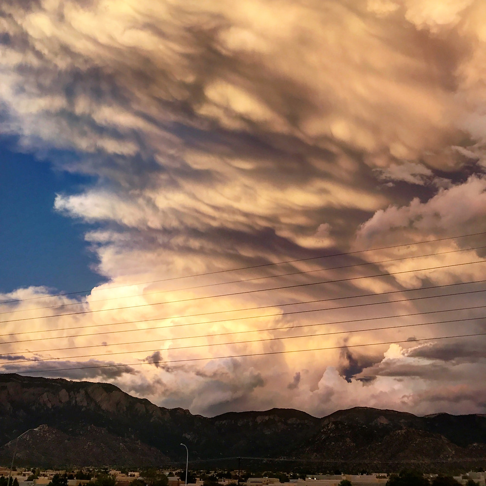 The view from my balcony over the Sandia Mountains