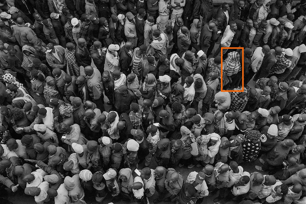 People in line kenya B&W orange box - fa