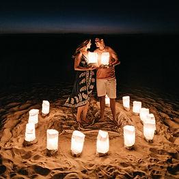 Beach couple with lanterns in circle_edi