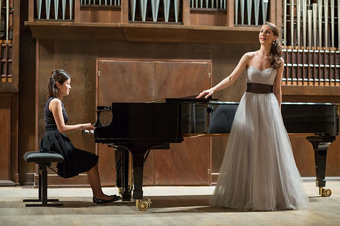 Woman pianist plays the piano and beauti
