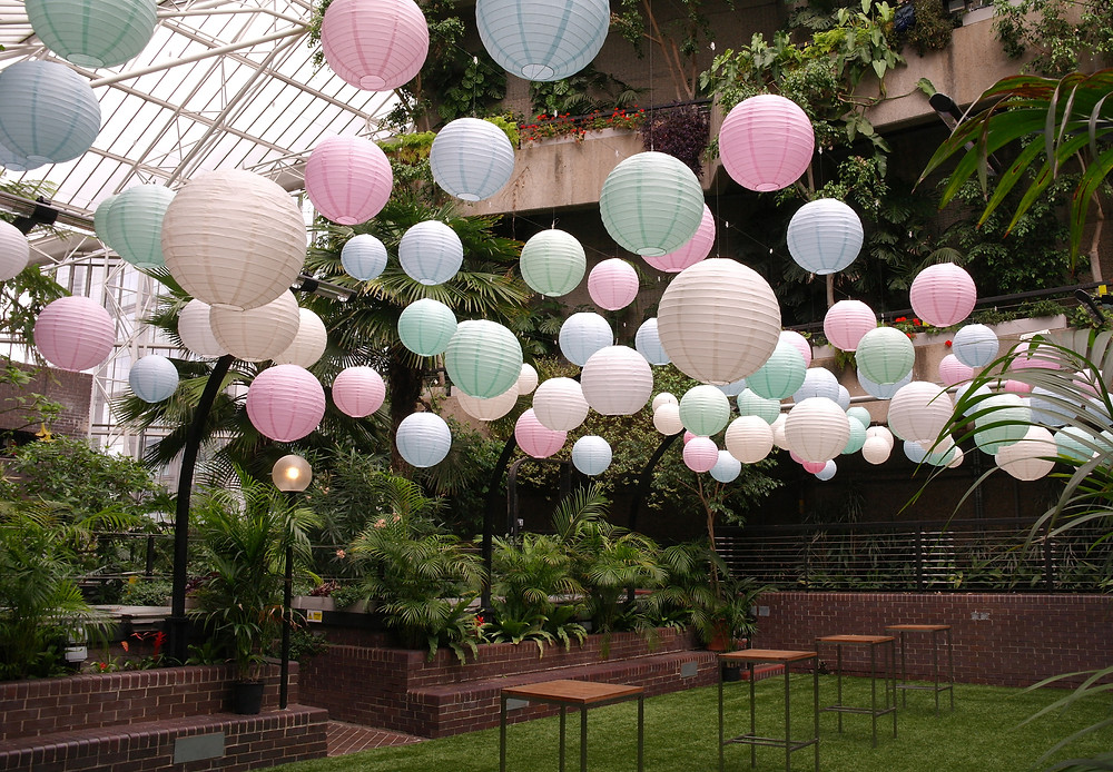 pastel hanging paper lanterns in the Barbican Conservatory