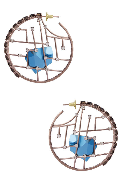 HOOPS IN METAALIC BLUE SWAROVSKI CRYSTAL AND SMOKY QUARTZ CRYSTALS AND BRASS IN