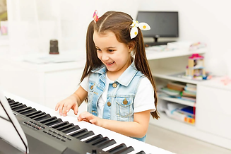 happy-small-girl-with-the-piano.jpg