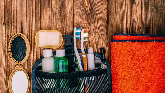 toiletries-flat-lay-toothbrush-shampoo-b
