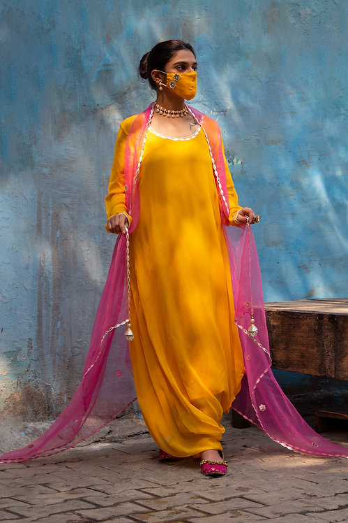 Alphanso yellow gown with fuchsia cape