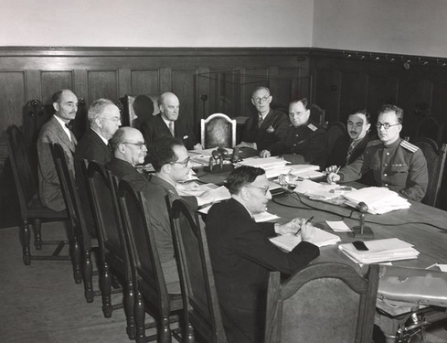Judges in their chamber with French and Russian translators
