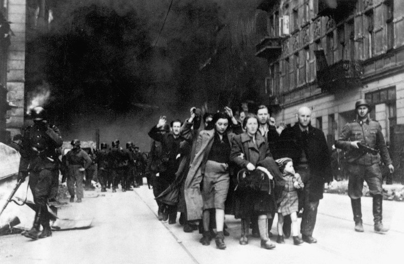 Hans Frank ordered the liquidation of the Warsaw Ghetto in May, 1943. Pictured are captured Jews being led by Waffen SS soldiers to Umschlagplatz, a holding area for thousands before shipment to death camps.