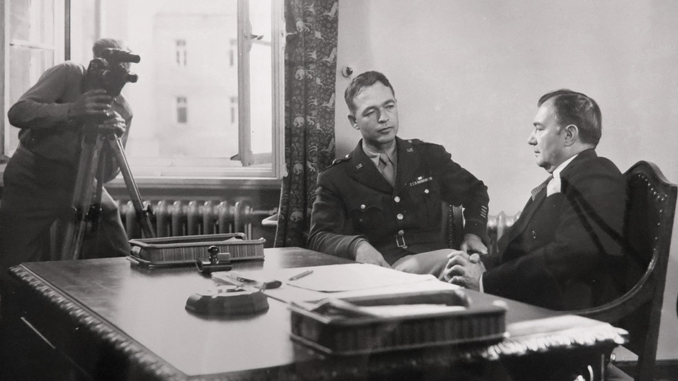 Telford Taylor (left) of the U.S. prosecution team would later become Chief Prosecutor for the 12 Subsequent Nuremberg Trials. He's pictured here with IMT Chief U.S. Prosecutor Robert H. Jackson preparing for documentary filming.
