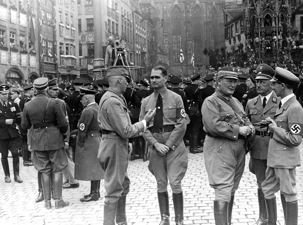 Rudolph Hess, Hermann Goering, Julius Striecher (with Minister of Propaganda Joseph Goebbels, far right) at the Nuremberg Rally Day, 1937
