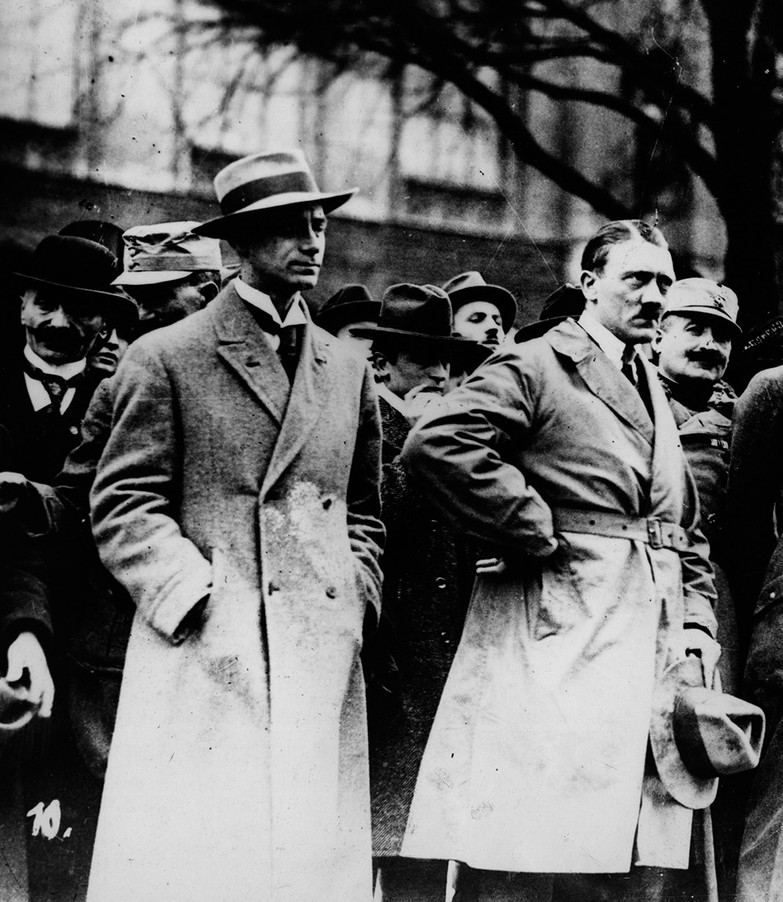 """Alfred Rosenberg, Nazi ideologue and founder of the """"""""Institute for Research into the Jewish Question"""" with Hitler in Munich, c. May, 1923. Rosenberg looted more than five million cultural objects from countries the Nazis conquered, including thousands of the world's greatest masterpieces. Art was stored in churches, castles and in underground salt mines – discovered and repatriated by the Allies' Monuments, Fine Arts, and Archives (MFAA) section."""