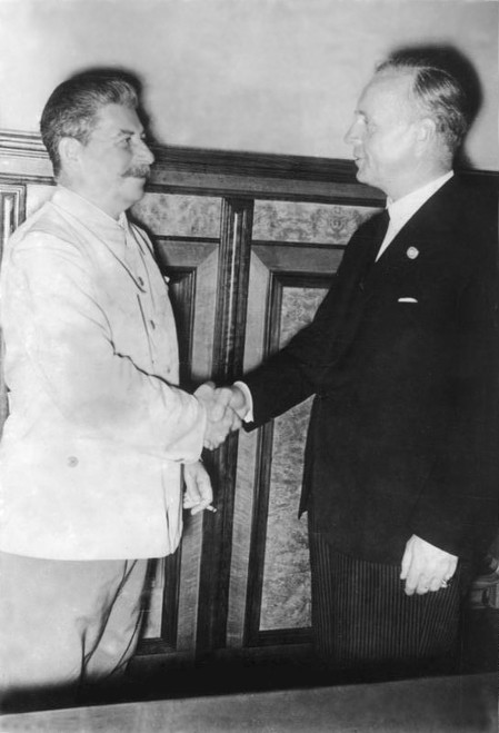 Joachim von Ribbentrop and Joseph Stalin after signing the German-Soviet Nonaggression Pact on August 23, 1939.  Both countries had agreed to take no military action against each other for the next 10 years. Hitler viewed this as a way to invade Poland unopposed only one week later – which started WWII. The German-Soviet pact fell apart in June 1941 when Nazi forces invaded the Soviet Union.