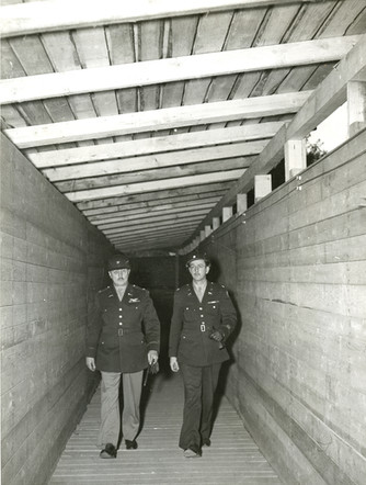 Colonel Burton Andrus, prison commandant and head of the Internal Security Detachment (ISD), walks through a constructed corridor between the jail and courthouse
