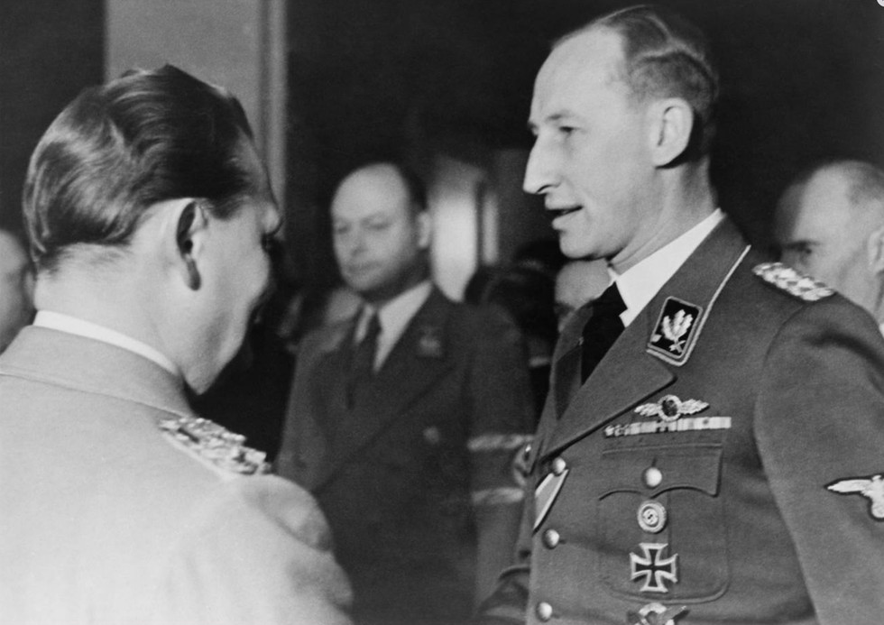 """Goering called for the """"Wannsee Conference"""" in January 1942, wherein middle level Nazi bureaucrats planned methods for the mechanized extermination of the Jews, or the """"Final Solution."""" Reinhard Heydrich, SS chief Heinrich Himmler's head deputy, held the meeting at a villa outside of Berlin named Wannsee. Nazis used the vague term """"final solution"""" to hide their policy of mass murder from the rest of the world. Pictured, Goering with Heydrich at another function that same month in 1942."""