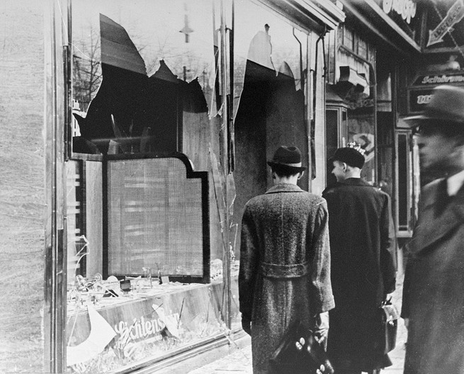 """Kristallnacht (the """"Night of Broken Glass""""): On Nov. 9, 1938 throughout Germany and occupied territories, Nazis burned down synagogues, destroyed thousands of Jewish businesses, and arrested more than 26,000 Jews. Pictured: a plundered and ruined shop in Berlin."""