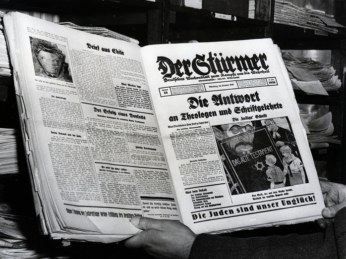 Front page of Nazi Germany's most notorious Jew-baiting paper 'Der Stürmer,' published and edited by Julius Streicher. Type at bottom reads 'The Jew is our misfortune.'