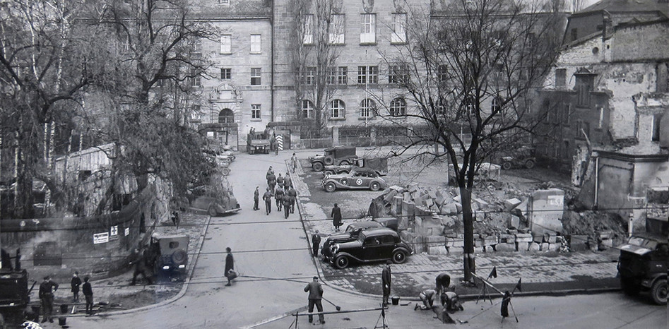 Taken Nov. 17, 1945 – 3 days before the trial started, glass windows broken in bombing raids have been replaced. Factories had to be reopened to produce glass and tile for the repair of Courtroom 600 and the entire Palace of Justice complex.
