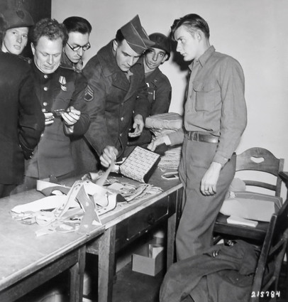Russians mingle with GIs at the Post Exchange (PX). For the Soviets, many of whom had never seen items like toothpaste and chewing gum, the PX was a sensation.