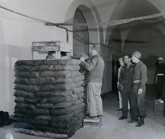 German POW constructs a sandbag barricade for security in the Palace of Justice