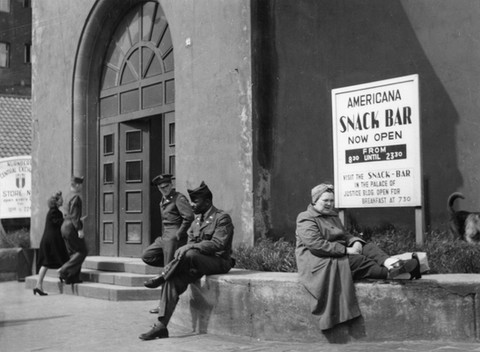 A German civilian (right) on break from work inside the Palace of Justice