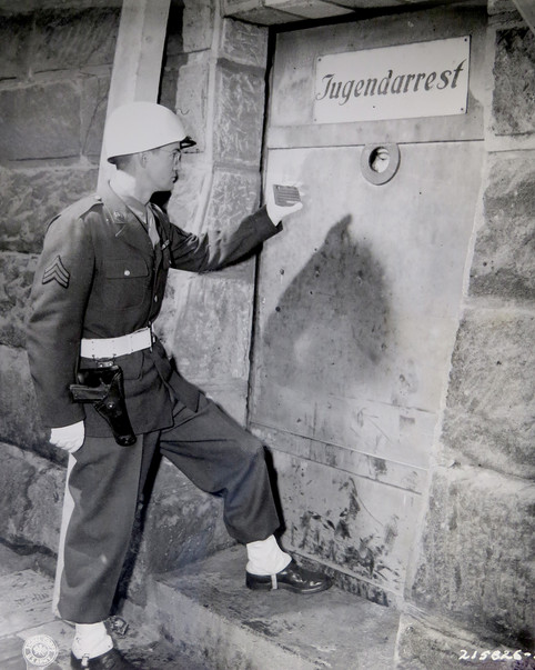 U.S. guard shows his ID at the prison entrance. Dressed as a court guard, it's likely he'll accompanying defendants to court that day.