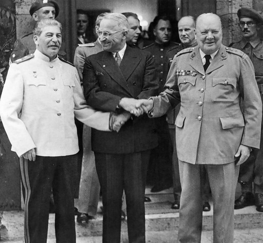 """The final """"Big Three"""" meeting between the Soviet Union, the United States, and Great Britain took place July 17, 1945. Roosevelt had died in April – just three weeks before the war in Europe ended; Harry Truman was now President. In addition to war crimes trials, the Allies discussed Japan's persistence in the east. Victory in the European Theater (VE Day) was May 9th; Victory in Japan (VJ Day) was August 14th. WWII officially ended in September, 1945."""