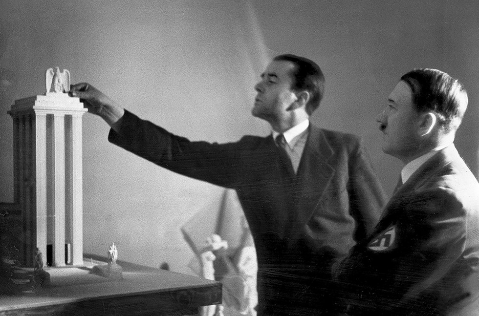 Albert Speer (left), Hitler's chief architect, presents his model of the German Pavilion, designed for the World's Fair in Paris 1937
