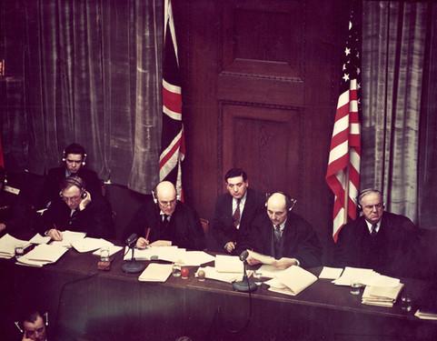 Judges bench, personal translators sit behind them
