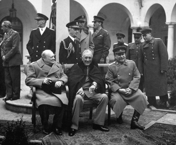 """The """"Big Three,"""" Churchill, Roosevelt, and Stalin, had begun discussions about prosecuting war crimes starting in 1942. Pictured at the Yalta Conference in February 1945, the Allies crafted terms for joint occupation of Germany and agreed to prosecute Nazi war criminals in the world's first international trial."""