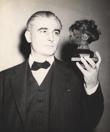 Thomas J. Dodd with the shrunken head of a concentration camp prisoner