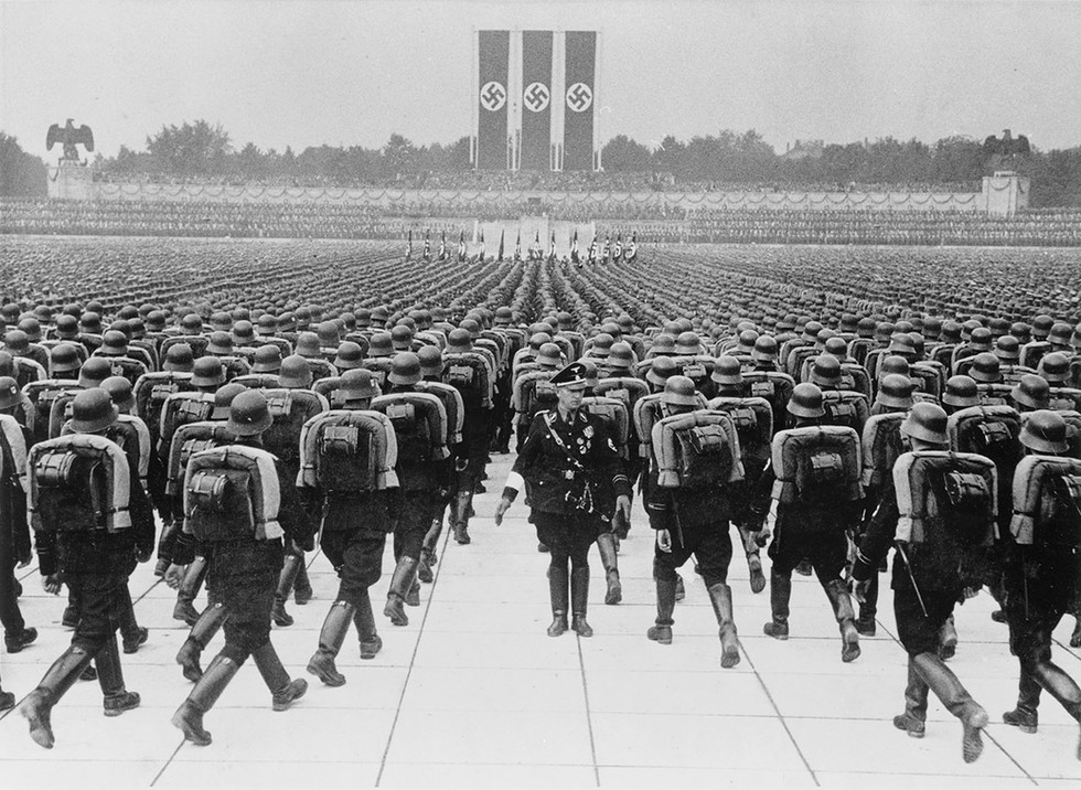 Soldiers in formation at the Nazi Party Rally in Nuremberg, 1937. These annual, weeklong events attracted over 500,000 attendees and were filled with pageantry and propaganda designed to unite the German people with the Nazi party.