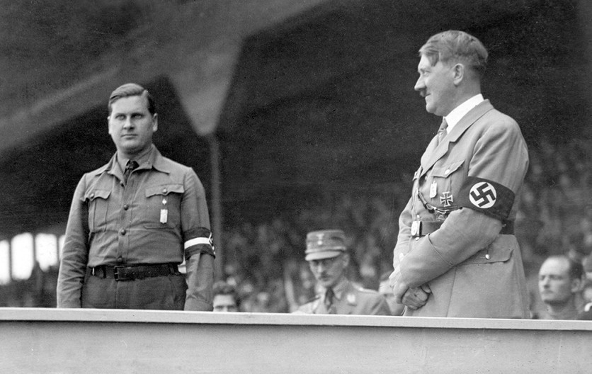Head of the Hitler Youth Baldur von Schirach on the speaker's platform at the 1933 Nazi Party Rally grounds. Before the Nazis took power, only 110,000 out of 4.5 million boys and girls were members. By 1939, the Hitler Youth claimed 9 million out of 10 million children.