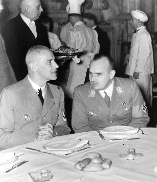 Hans Frank (right), Hitler's personal lawyer and Governor General of occupied Poland after the war broke out, with Wilhelm Frick at a Berlin Castle dinner, 1938