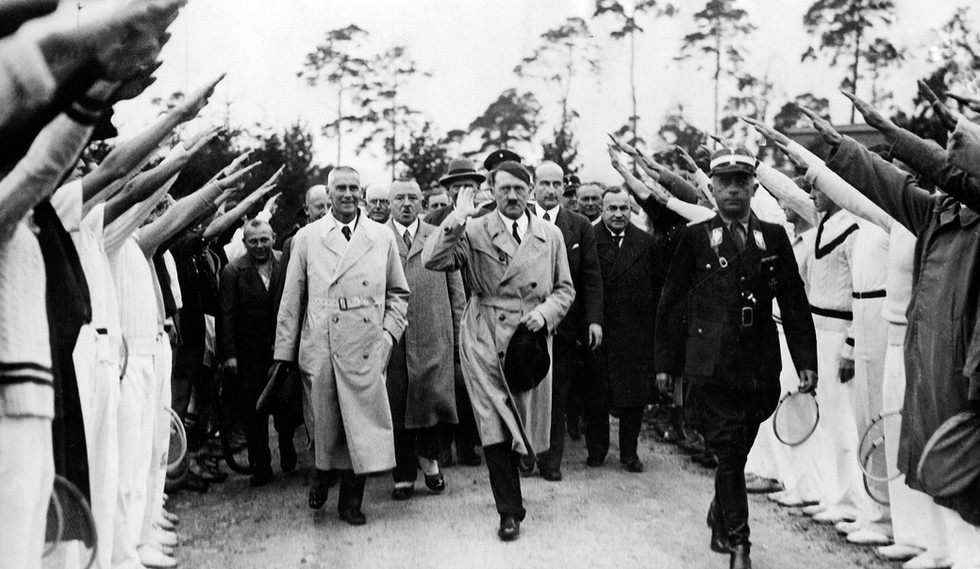 German Olympic athletes greet Hitler and Interior Minister Wilhelm Frick during preparations for the 1936 Berlin games. In track and field, African American Jesse Owens won 4 gold medals – disproving Hitler's Aryan racial theory.
