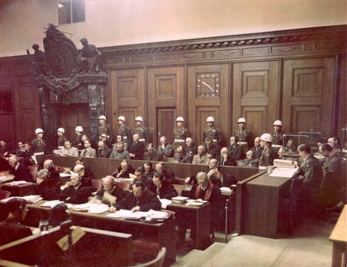 One of the rare color photographs of defendants in the dock. Court proceedings began at 10am every day for 216 days of trial, 403 sessions total over 10 months.
