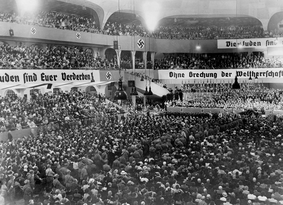 Anti-Semitic rally at Berlin's Sportpalast auditorium, where Nazi propagandist Julius Streicher would speak on August 16, 1935. Within a month, Germany would adopt the Nuremberg Laws (co-authored by Wilhelm Frick), stripping German Jews of their citizenship and civil rights.