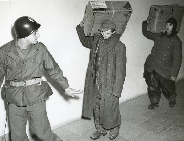 German POWs put to work in the Palace of Justice renovation, under guard from the US Military