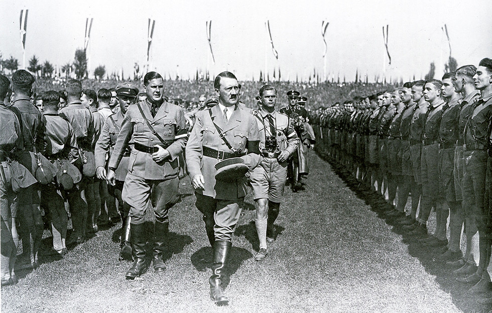 Baldur von Shirach and Hitler with members of the Hitler Youth at the 1934 Nazi Party Rally